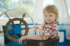 Little sweet girl on yacht Stock Images