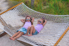 Little sweet girls relaxing in hammock on summer Stock Images
