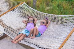 Little sweet girls relaxing in hammock on summer Royalty Free Stock Image