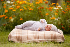 Little sweet sleeping baby outdoors Stock Image