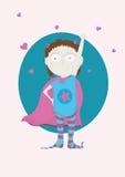 Superhero girl. Little superheroine girl in pajamas with hearts Stock Photo