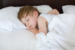 Little sweet toddler boy sleeping in his bed Stock Images