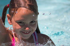 Little Swimmer. Little Girl in Pool - Summer fun Stock Photos