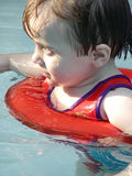 Little Swimmer. Young man keepnig it safe in his little swimmer suit Stock Image