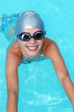 Little Swimmer. Little girl in a gray swimming cap and goggles with a big smile Royalty Free Stock Photography