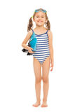 Little swimmer standing with flippers and goggles. Little swimmer in stripped swimwear standing full length with flippers and goggles Stock Photos