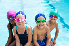 Little swimmers sitting at poolside Royalty Free Stock Photography