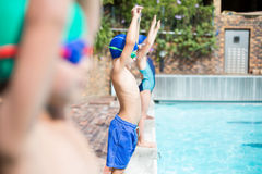 Little swimmers standing at poolside Royalty Free Stock Images