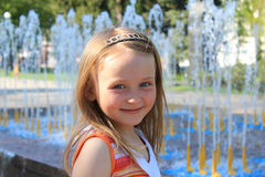 Little sympathetic girl near fountains Stock Photography
