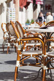 Little tables and chairs in small street cafe Stock Image