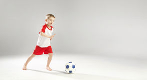 Little talented boy playing football Royalty Free Stock Image