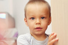 Little tanned boy looking royalty free stock photography