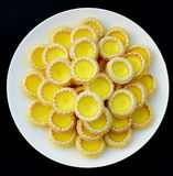Little tarts. Chinese egg tarts a tasty little snack. Yellow egg tarts inlaid with white cream, aroma, sweet but not greasy Royalty Free Stock Photography