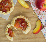 Little tarts with fresh peaches Stock Images