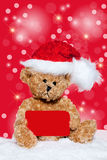 Little Teddy bear with christmas card Royalty Free Stock Images