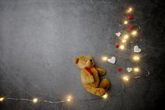 Little teddy bear with Christmas tree on concrete background. Christmas, toy, bear, teddy, holiday, decoration, red, cute, white, gift, love, xmas, object, toys royalty free stock photo