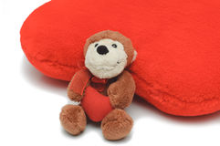Little teddy-bear holding red heart Royalty Free Stock Photos