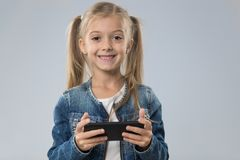 Little Teenage Girl Using Cell Smart Phone, Small Kid Happy Smiling Child royalty free stock photo