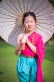 Little Thai Girl, Child, in Traditional Thai Costume. Child, Thai girl, in traditional Thai costume royalty free stock image
