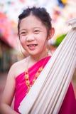 Little Thai Girl, Child, in Traditional Thai Costume. Child, Thai girl, in traditional Thai costume royalty free stock photos