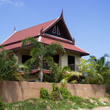 Little Thai houses and palm trees Stock Image