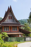 Little Thai houses and palm trees Royalty Free Stock Photography
