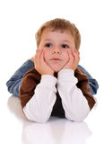 Little Thinker. Adorable preschool boy thinking with his head in his hands.  Isolated Stock Image