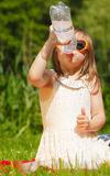 Little thirsty girl child drink water from plastic bottle, outdoor Stock Photos