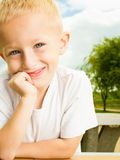 Little thoughtful boy blondevchild portrait outdoor Royalty Free Stock Photography