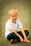 Little thoughtful boy child portrait outdoor Stock Images