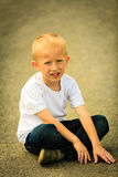 Little thoughtful boy child portrait outdoor Royalty Free Stock Photography