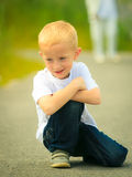 Little thoughtful boy child portrait outdoor Royalty Free Stock Photos
