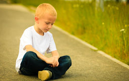 Little thoughtful boy child portrait outdoor Royalty Free Stock Image
