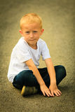 Little thoughtful boy child portrait outdoor Stock Image