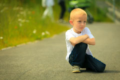 Little thoughtful boy child portrait outdoor Royalty Free Stock Images