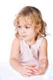 Little thoughtful girl sitting at table Stock Photography