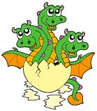 Little three headed dragon in egg royalty free stock photo