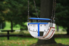 Little Tikes Swing. A baby swing in a childrens playground Stock Photography