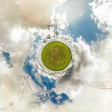Little tiny planet. Spherical aerial 360 view panorama near high voltage electric pylon towers in field with beautiful clouds royalty free stock photo