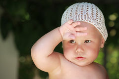 Little tired baby girl wipes off the sweat Royalty Free Stock Images