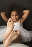 Little tired ballet dancer relaxing alone Royalty Free Stock Photo