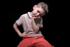 Little tired boy with hands on hips Stock Photos