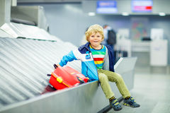 Little tired kid boy at the airport, traveling Stock Image
