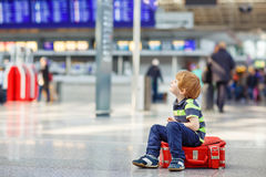 Little tired kid boy at the airport, traveling Royalty Free Stock Images