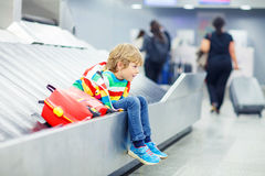Little tired kid boy at the airport, traveling Stock Images