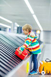 Little tired kid boy at the airport, traveling Stock Photo