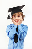 Little tired professor in academic hat on white background Royalty Free Stock Photography