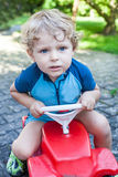 Little todder boy playing with big toy car Royalty Free Stock Photos