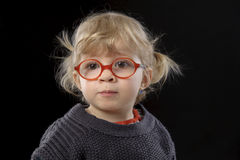 Little todder with glasses. Little toddler with glasses on black Royalty Free Stock Photography