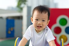 Little toddler Asian boy having fun on playground Royalty Free Stock Photography